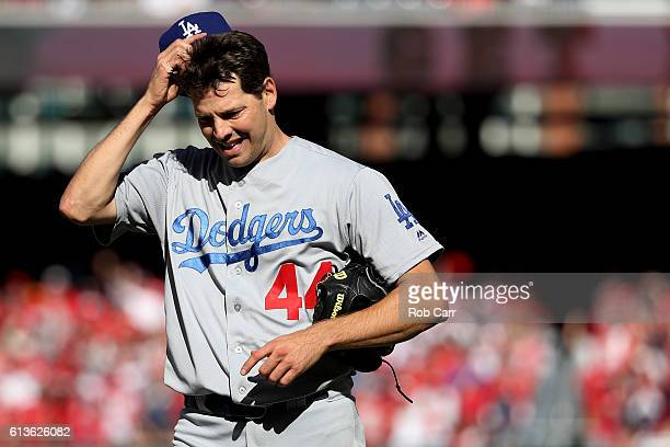 Rich Hill of the Los Angeles Dodgers walks off of the field in the fifth inning against the Washington Nationals during game two of the National...