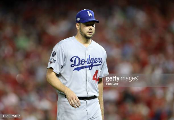 Rich Hill of the Los Angeles Dodgers walks off the field after being pulled in the third inning against the Washington Nationals in game four of the...