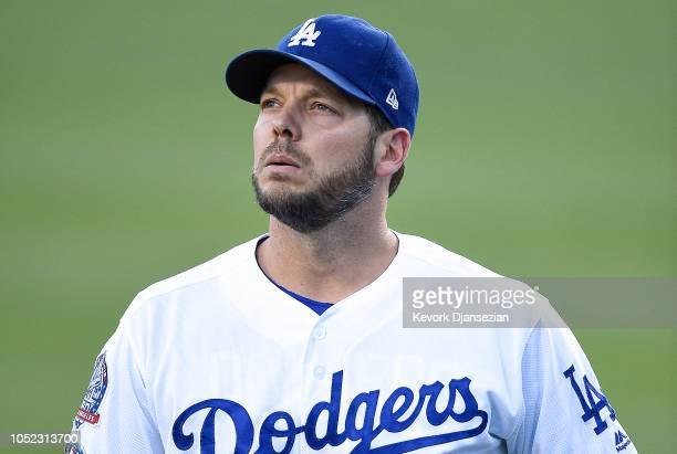 Rich Hill of the Los Angeles Dodgers warms up prior to Game Four of the National League Championship Series against the Milwaukee Brewers at Dodger...