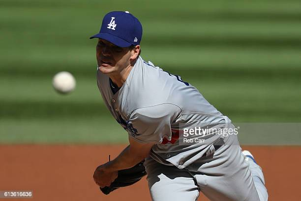 Rich Hill of the Los Angeles Dodgers works against the Washington Nationals in the first inning during game two of the National League Division...