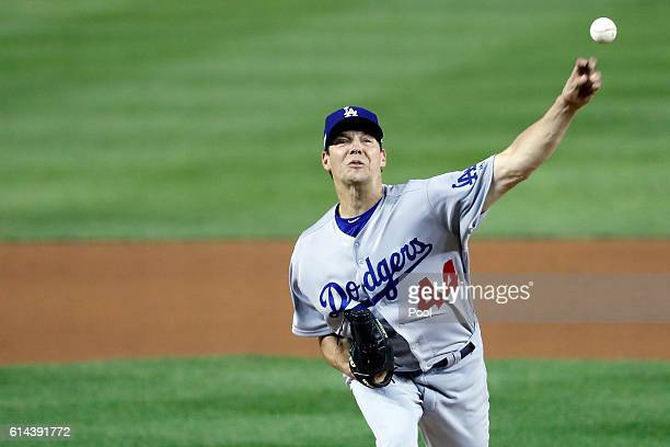 Rich Hill of the Los Angeles Dodgers works against the Washington Nationals in the first inning during game five of the National League Division...