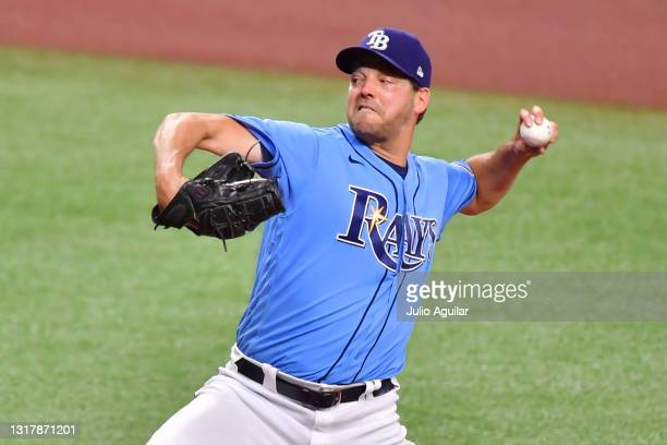 Rich Hill of the Tampa Bay Rays delivers a pitch in the first inning against the New York Yankees at Tropicana Field on May 13, 2021 in St...