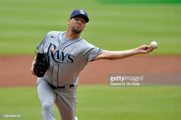 Rich Hill of the Tampa Bay Rays pitches in the first inning against the Atlanta Braves at Truist Park on July 18, 2021 in Atlanta, Georgia.