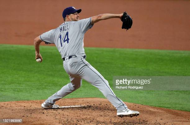 Rich Hill of the Tampa Bay Rays pitches in the first inning against the Texas Rangers at Globe Life Field on June 05, 2021 in Arlington, Texas.