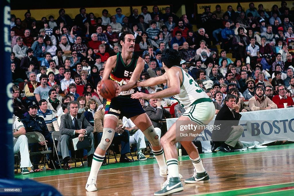 Rich Kelley #53 of the Denver Nuggets looks to make a move against Kevin McHale #32 of the Boston Celtics during a game played in 1983 at the Boston Garden in Boston, Massachusetts.