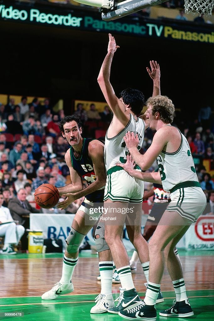 Rich Kelley #53 of the Denver Nuggets looks to make a move against Kevin McHale #32 and Larry Bird #33 of the Boston Celtics during a game played in 1983 at the Boston Garden in Boston, Massachusetts.