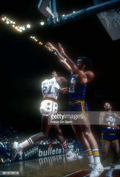Rich Kelley of the New Orleans Jazz leaps at the pass from Dave Bing of the Washington Bullets during an NBA basketball game circa 1976 at the...