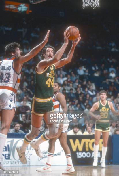 Rich Kelley of the Utah Jazz looks shoots over Jeff Ruland of the Washington Bullets during an NBA basketball game circa 1983 at the Capital Centre...
