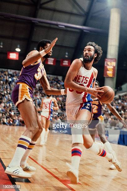 Rich Kelly of the New jersey Nets dribbles against the Los Angeles Lakers during a game played circa 1975 at the Rutgers Athletic Center in...