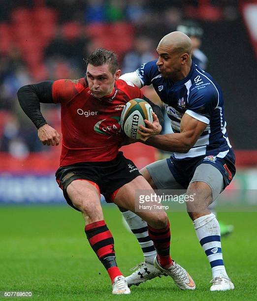 Rich Lane of Jersey is tackled by Tom Varndell of Bristol during the Greene King IPA Championship match between Bristol and Jersey at Ashton Gate on...