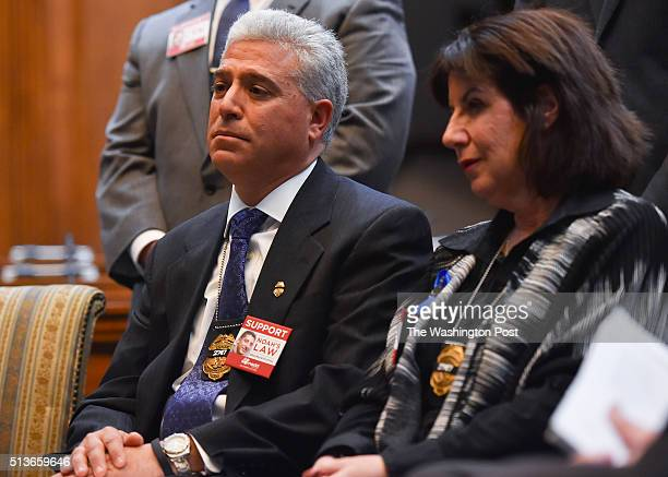 Rich Leotta and his wife Marcie Goldman parents of Montgomery County Police Officer Noah Leotta listen to speakers at a MADD press conference to...
