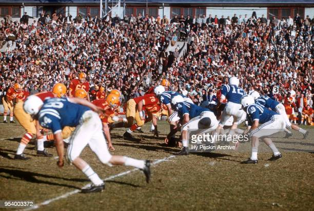 Rich Mayo of the Air Force Falcons drops back to hand off during an NCAA game against the Denver Pioneers on November 8, 1958 at DU Stadium in...