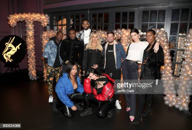 Rich Paul Simon Tristan Thompson Khloe Kardashian Lucas Newton Kendall Jenner Justine Skye Jordan Woods and Kylie Jenner pose for a photo as Remy...