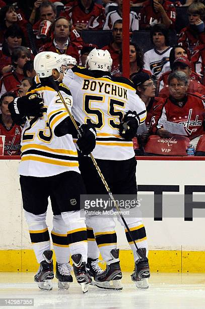 Rich Peverley celebrates with Johnny Boychuk and Chris Kelly of the Boston Bruins after scoring a goal against the Washington Capitals in Game Three...