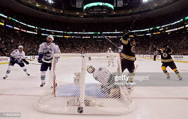 Rich Peverley of the Boston Bruins celebrates after Mark Recchi scored a goal in the second period against Roberto Luongo of the Vancouver Canucks...