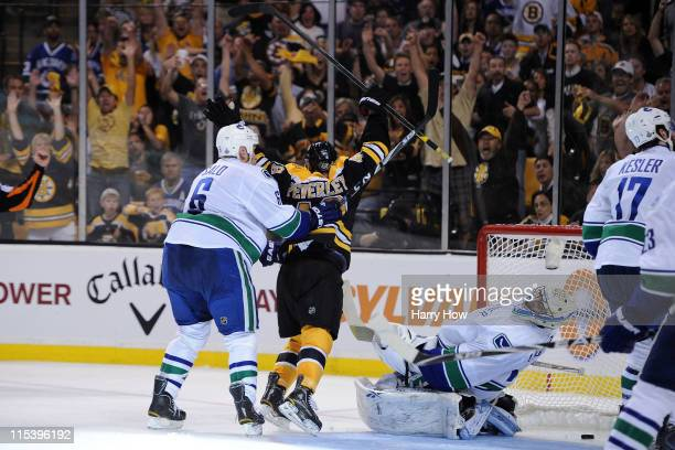 Rich Peverley of the Boston Bruins celebrates after scoring a goal in the second period against Roberto Luongo of the Vancouver Canucks during Game...