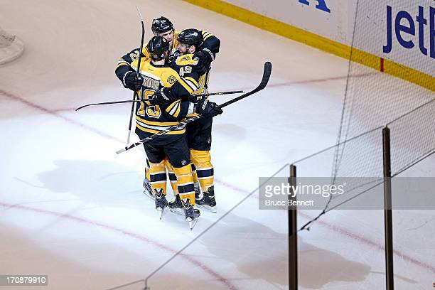 Rich Peverley of the Boston Bruins celebrates with Daniel Paille and Tyler Seguin after scoring a goal in the first period against the Chicago...