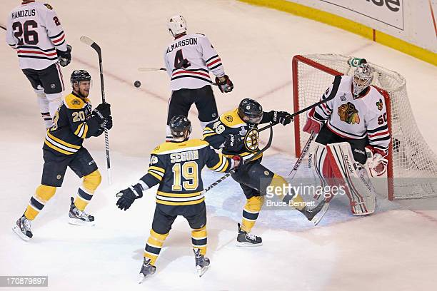 Rich Peverley of the Boston Bruins celebrates with teammates Daniel Paille and Tyler Seguin after scoring a goal against Corey Crawford of the...