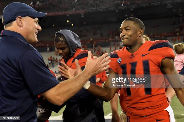 Rich Rodriguez head coach of the Arizona Wildcats and quarterback Khalil Tate celebrate after the game against the Washington State Cougars at...