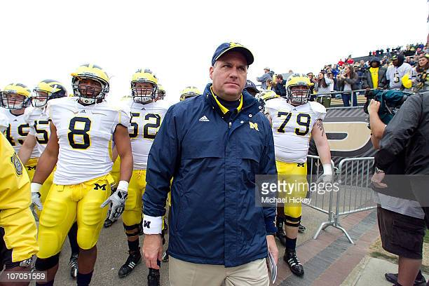 Rich Rodriguez head coach of the Michigan Wolverines prepares to lead the team on the field before action against the Purdue Boilermakers November...