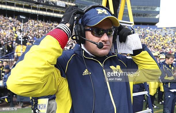 Rich Rodriguez head football coach of the University of Michigan gets ready for the game against the Delaware State Hornets at Michigan Stadium on...