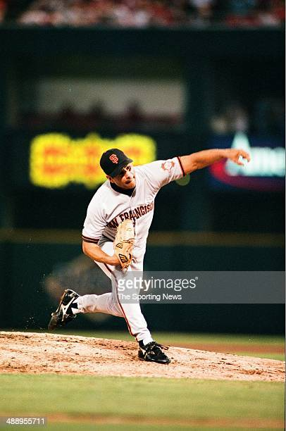 Rich Rodriguez of the San Francisco Giants pitches against the St. Louis Cardinals at Busch Stadium on July 19, 1997 in St. Louis, Missouri. The...