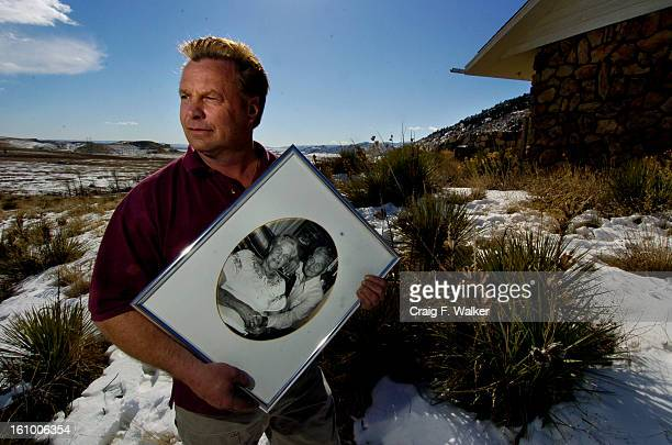 Rich Rooney poses for a portait with a photograph of his late grandparents, Evelyn and Alex Rooney, outside their home on the Rooney Property in...