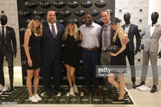 Rich Salgado Roquan Smith and Daryl Johnston with the NHP Girls attend the Fashion Football Event at Saks Off 5TH> on April 25 2018 in Grand Prairie...