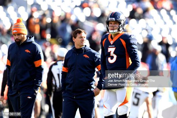 Rich Scangarello Offensive coordinator of the Denver Broncos with Denver Broncos quarterback Drew Lock before the Denver Broncos take on the Los...