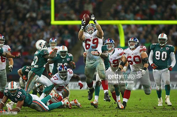 Rich Seubert of New York Giants jumps to catch the ball during the NFL Bridgestone International Series match between New York Giants and Miami...
