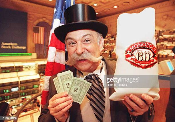 Rich Uncle Pennybags the Monopoly game figure shows some of his funny money as he prepares to strike the opening bell at the American Stock Exchange...