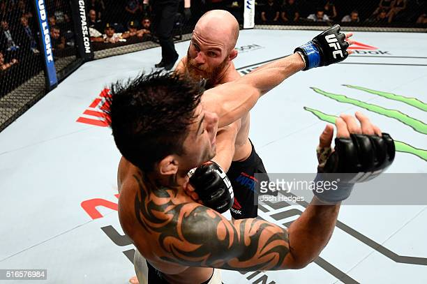 Rich Walsh of Australia punches Viscardi Andrade of Brazil in their welterweight bout during the UFC Fight Night event at the Brisbane Entertainment...