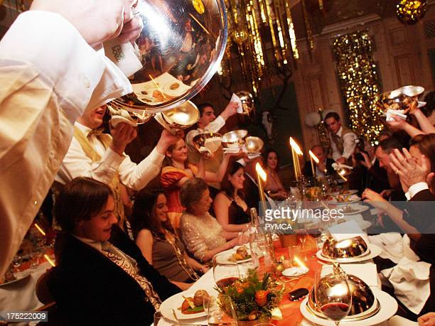 Rich, Wealthy people sitting down to a lavish Banquet, New Year's Eve, 2005 / 2006.