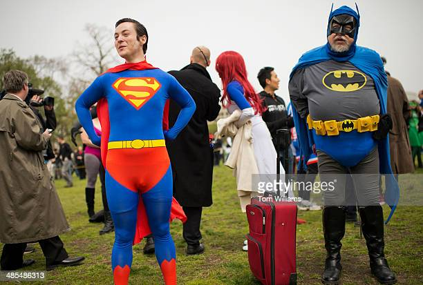 Rich Willet of Sterling Va dressed as Batman and an identified Superman arrive for an event near the Capitol reflecting pool hosted by Awesome Con...