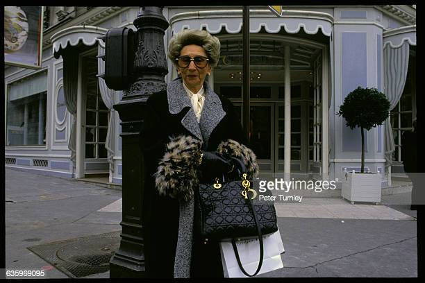 Rich Woman Outside Christian Dior Store