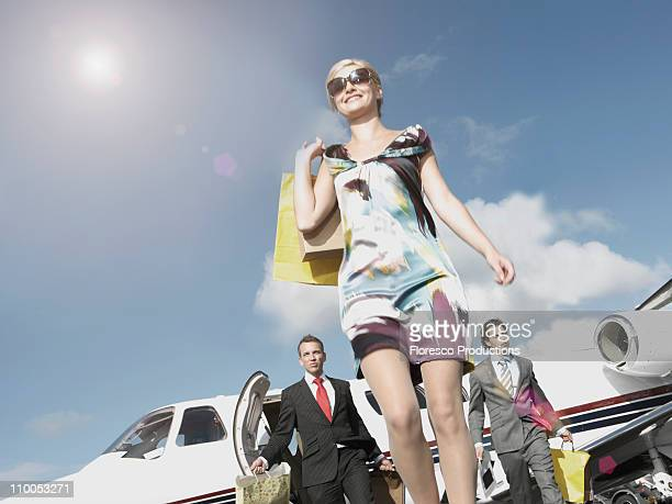 Rich woman traveling in private jet