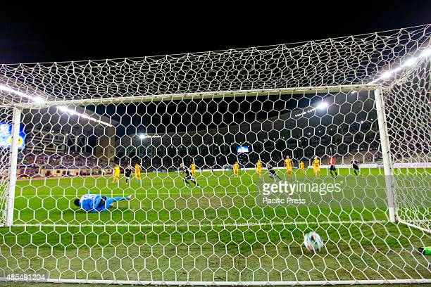Richard Almedia background scores his side's opening goal during the UEFA Europa League playoff first leg match between Switzerlands BSC Young Boys...