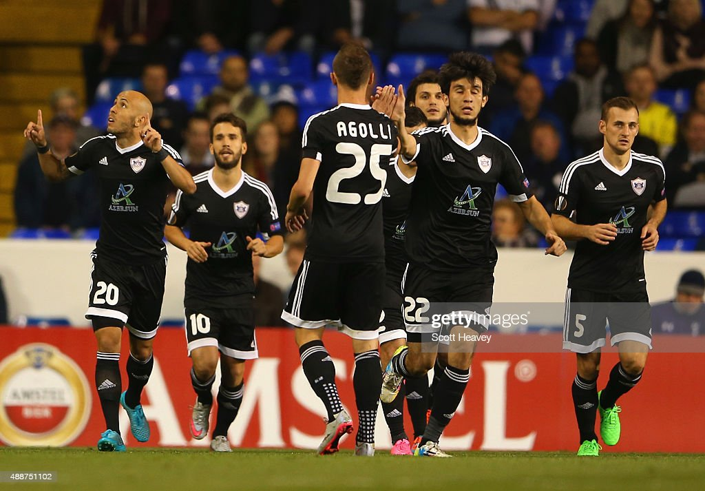 Richard Almeida de Oliveria of FK Qarabag (L) celebrates scoring the opening goal from the penalty spot with team amtes during the UEFA Europa League Group J match between Tottenham Hotspur FC and Qarabag FK at White Hart Lane on September 17, 2015 in London, United Kingdom.