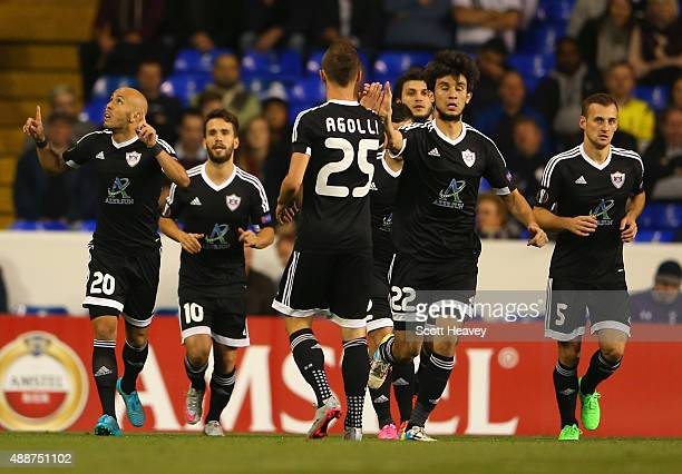 Richard Almeida de Oliveria of FK Qarabag celebrates scoring the opening goal from the penalty spot with team amtes during the UEFA Europa League...