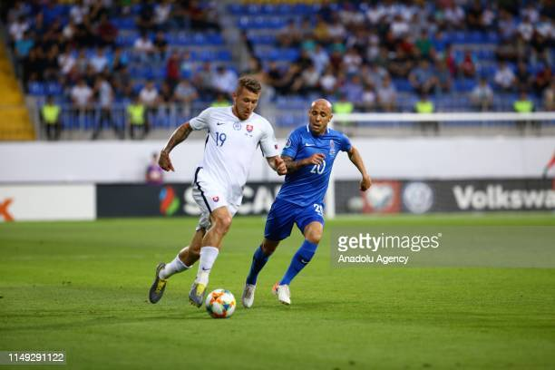 Richard Almeida of Azerbaijan in action against Juraj Kucka of Slovakia during a UEFA Euro 2020 European Championship Qualifiers Group E match...