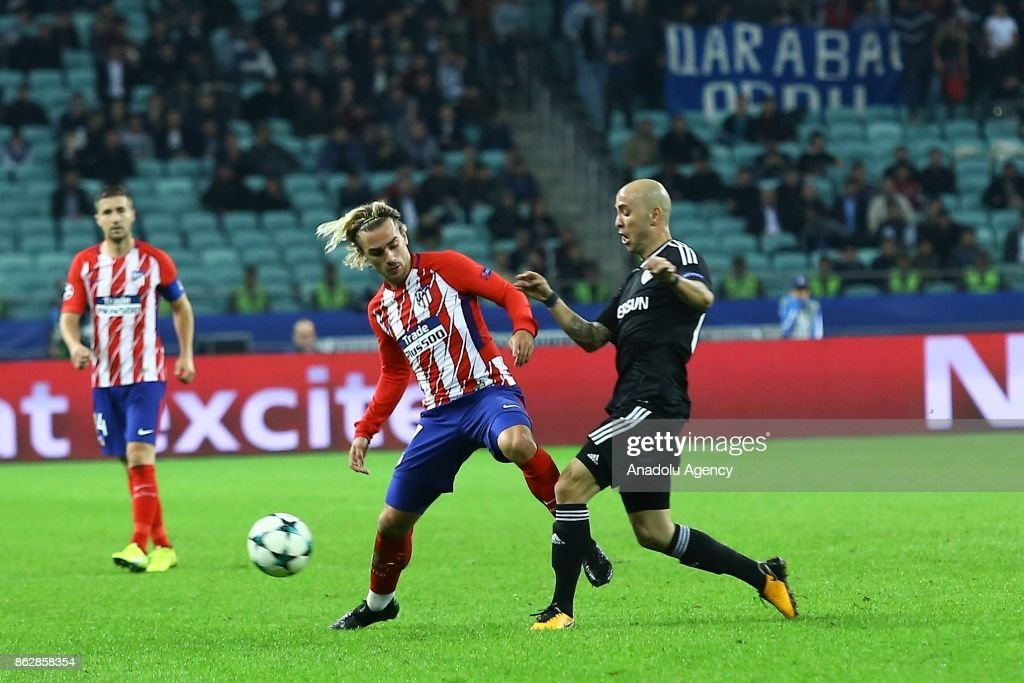 Richard Almeida (R) of Qarabag Agdam in action against Antonie Griezmann (L) of Atletico Madrid during the UEFA Champions League Group C soccer match between Qarabag Agdam and Atletico Madrid in Baku, Azerbaijan on October 18, 2017.