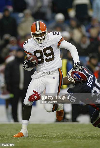 Richard Alston of the Cleveland Browns is nearly tackled by Joe Burns of the Buffalo Bills during the game on December 12, 2004 at Ralph Wilson...