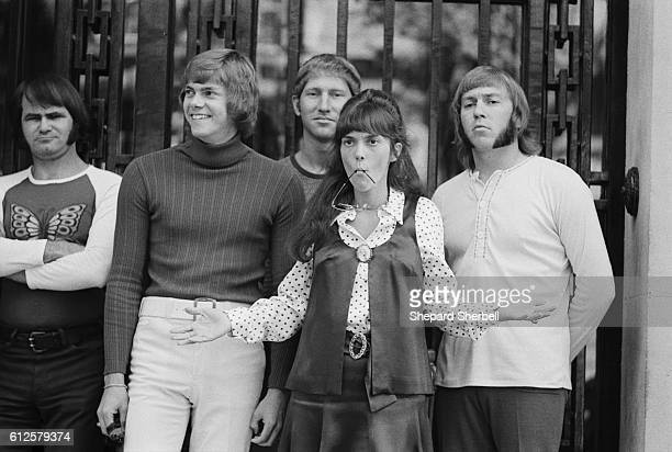 Richard and Karen Carpenter posing with their band for pictures during a European publicity tour