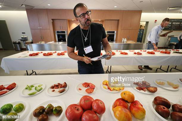 Richard Ansara chef/owner of Tresca studies the taste of the heirloom tomatoes in the kitchen at the Boston Public Market on Aug 22 2017 He was one...