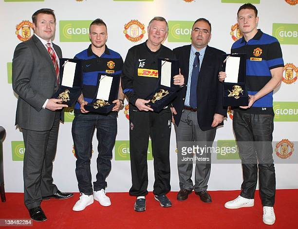 Richard Arnold , Tom Cleverley , Sir Alex Ferguson and Phil Jones of Manchester United are presented with gifts by Haris Kotsibos, CEO of Globul,...