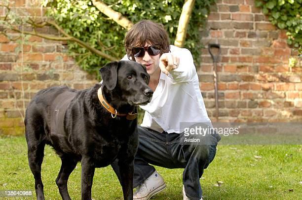 Richard Ashcroft solo artist and former lead singer of The Verve taken in his garden at home in Gloucestershire England 15th March 2006 He is with...