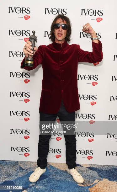 Richard Ashcroft winner of the Outstanding Contribution to British Music Award poses in the winners room at The Ivors 2019 at Grosvenor House on May...