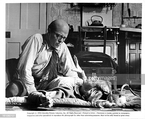 Richard Attenborough attends to Judy Geeson in a scene from the film '10 Rillington Place' 1971