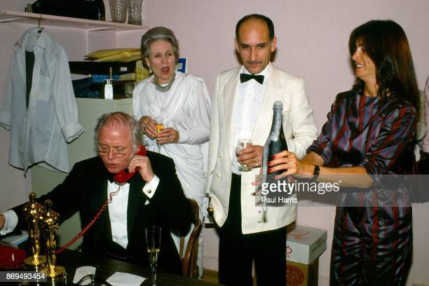 Richard Attenborough makes a phone call to friends back home in the UK in a back room at the Kate Mantalini restaurant Beverly Hills after the movie...