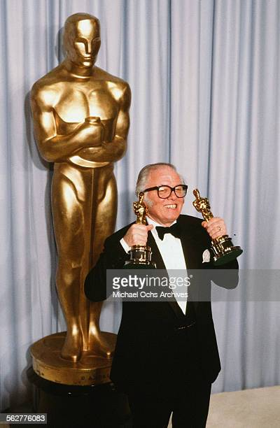 Richard Attenborough poses backstage after winning Best Director and Best Picture for Gandhi at the 55th Academy Awards at Dorothy Chandler Pavilion...